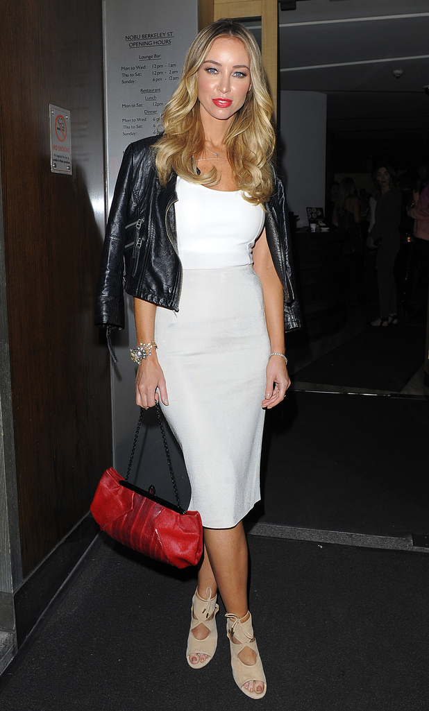 Lauren Pope arrives at Nobu Berkeley Street restaurant in Mayfair on October 2, 2014 in London, England.