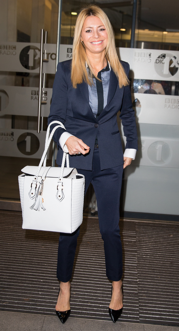 Tess Daly wears a navy suit while outside the BBC Radio 1 studios in London, England - 30 September 2014