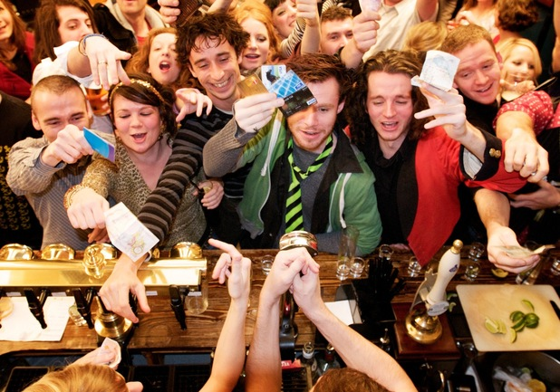People spending lots of money at bar