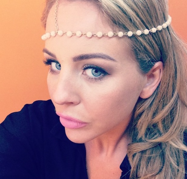 TOWIE star Lydia Bright poses in pearl and gold head chain from her own range for Vintage Styler, Ibiza, 29 September 2014