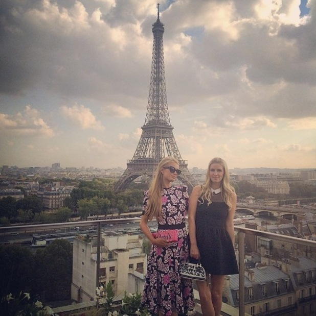 Paris Hilton and Nicky Hilton pose by the Eiffel Tower in Paris, France - 3 October 2014