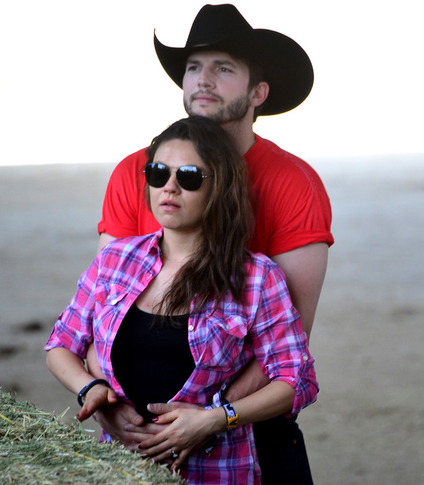 Actors Ashton Kutcher and Mila Kunis attend day 1 of 2014 Stagecoach: California's Country Music Festival at the Empire Polo Club on April 25, 2014