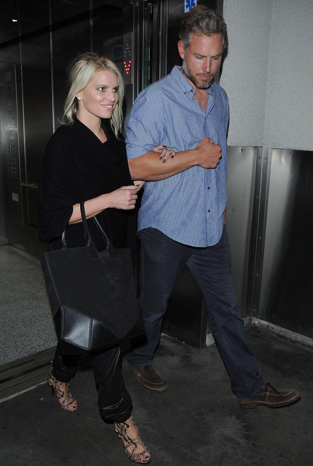 Jessica Simpson and Eric Johnson arrive at LAX airport - 10/02/2014.