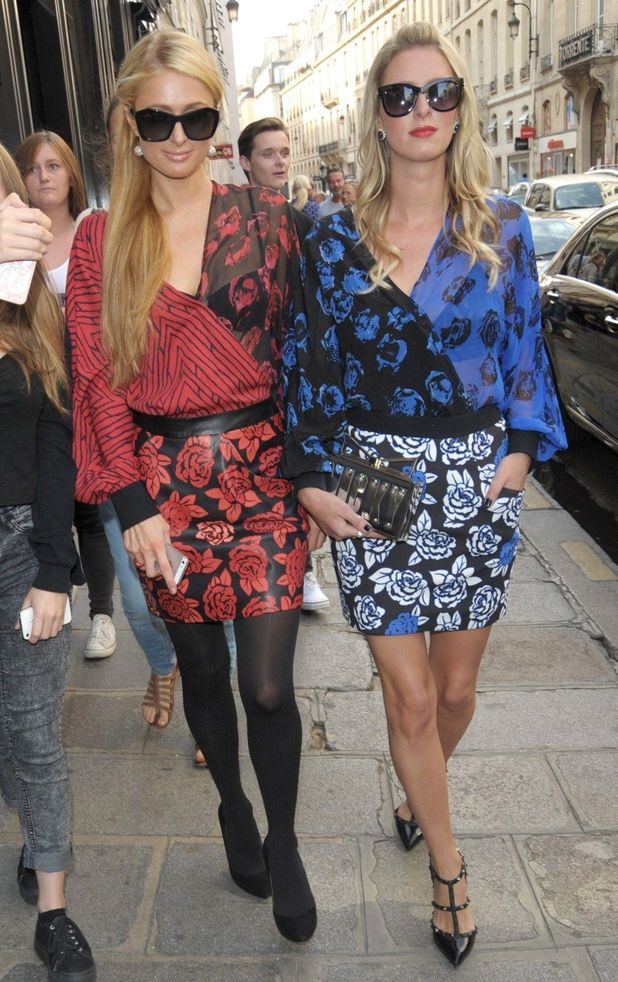 Paris Hilton and Nicky Hilton step out at Paris Fashion Week in France, 28 September 2014