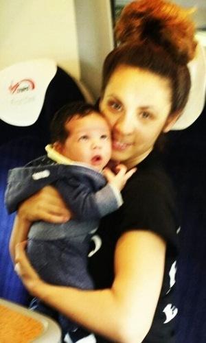 AJ Azari with baby son Omré on the train - 5 October 2014.