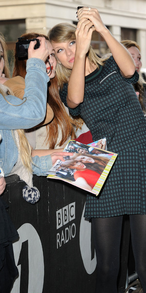 Taylor Swift takes selfies with fans outside Radio 1, BBC Studio, London 9 October