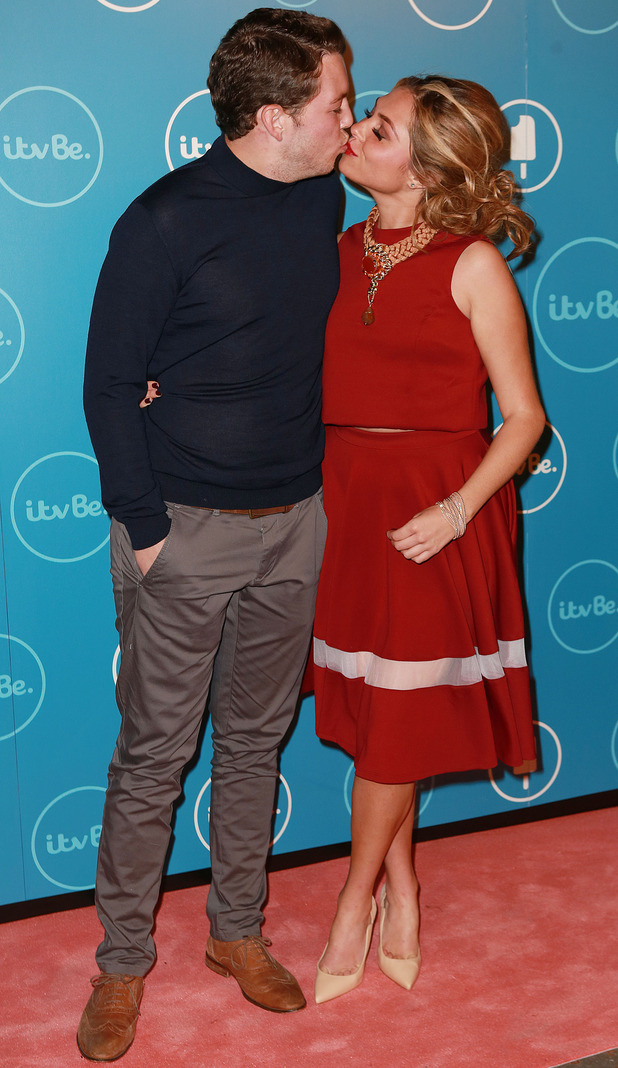 Fran Parman and James Diags Bennewith share a kiss at ITVBe launch, London 7 October