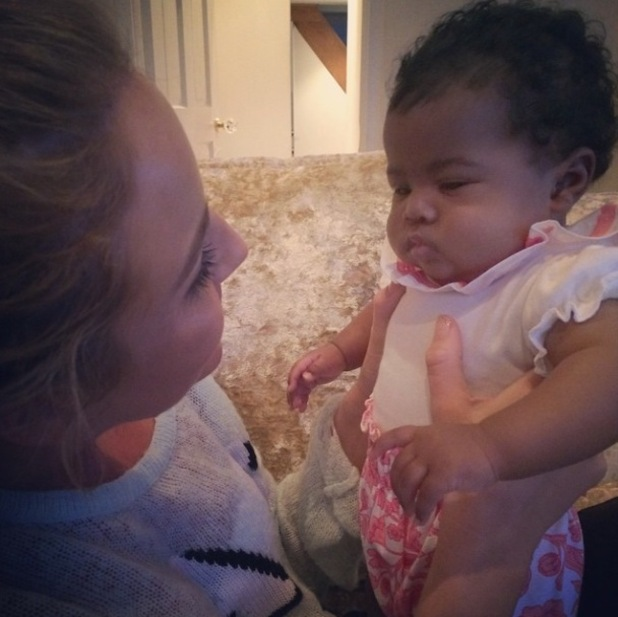 TOWIE's Lydia Bright cuddles Danni Park-Dempsey's daughter Summer-Rose while babysitting - 5 October 2014