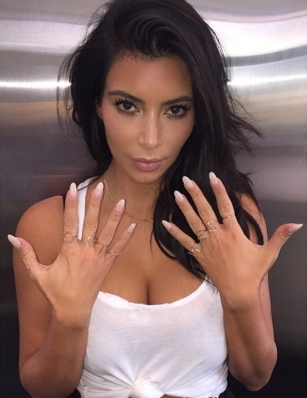Kim Kardashian West wears 'North West' gold initial rings in an Instagram picture - 6 October 2014