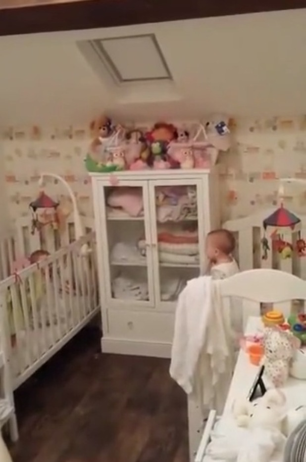 Baby twins Megan and Molly playing peek-a-boo, 2