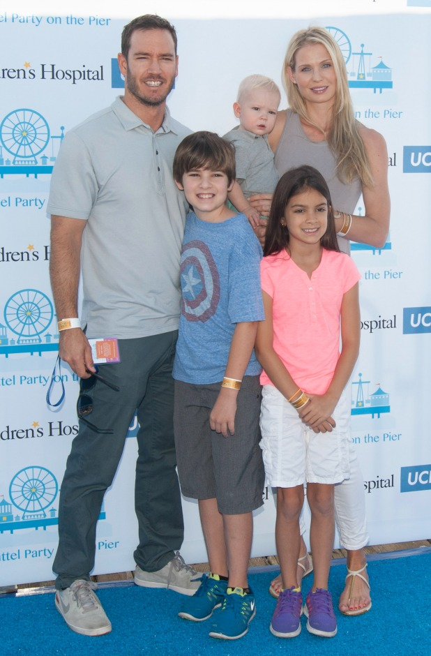 Mark-Paul Gosselaar (L), his wife Catriona McGinn, and children Michael Gosselaar, Dekker Gosselaar and Ava Gosselaar attend Mattel's 5th Annual Party On The Pier Hosted By Sarah Michelle Gellar at Santa Monica Pier on October 5, 2014