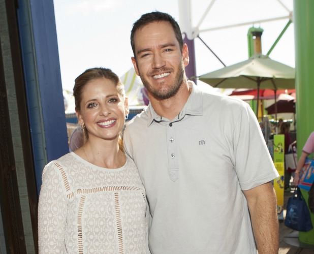 Actors Sarah Michelle Gellar and Mark-Paul Gosselaar attend Mattel's 5th Annual Party On The Pier Hosted By Sarah Michelle Gellar at Santa Monica Pier on October 5, 2014 in Santa Monica, California.