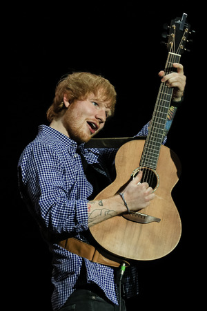 Ed Sheeran performs on stage at O2 Arena on October 12, 2014 in London, United Kingdom.