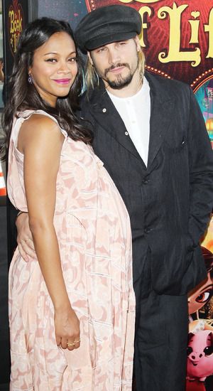 Zoe Saldana and husband Marco Perego arrives at the Los Angeles premiere of 'Book Of Life' held at Regal Cinemas L.A. Live on October 12, 2014 in Los Angeles, California.