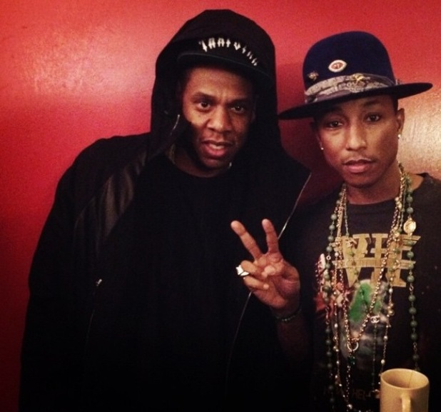 Jay Z and Pharrell Williams backstage at his concert in Paris. 13 October 2014.