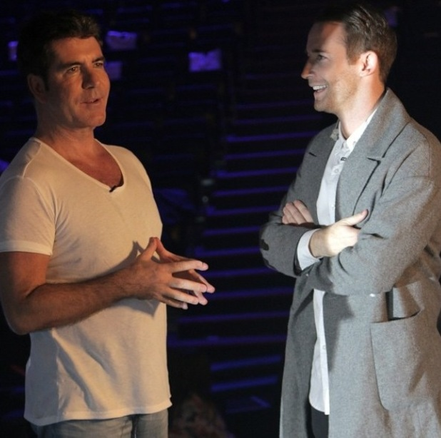 X Factor's Jay James with mentor Simon Cowell during soundcheck 17 October.