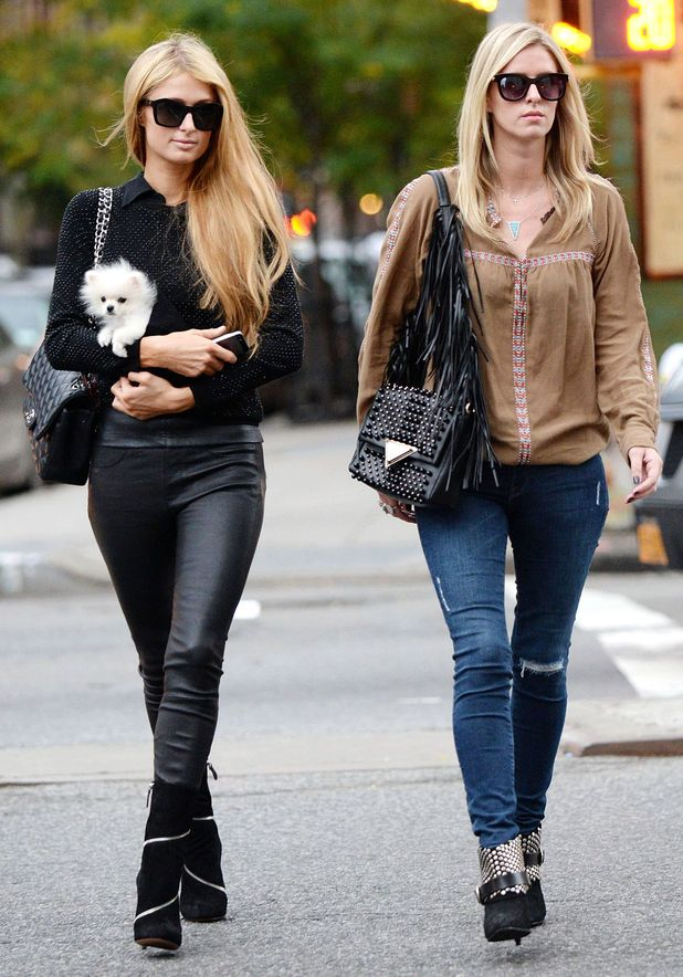 Paris Hilton and Nicky Hilton take pet puppy Prince Hilton for a stroll in New York, America - 15 October 2014