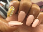 Mel B rocks nude manicure with gold studs and gems during The X Factor
