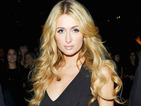 Paris Hilton pairs head-to-toe black outfit with tumbling curls in LA