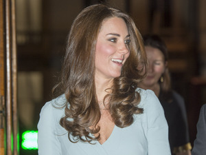 Pregnant Kate Middleton radiant in powder blue gown at awards ceremony