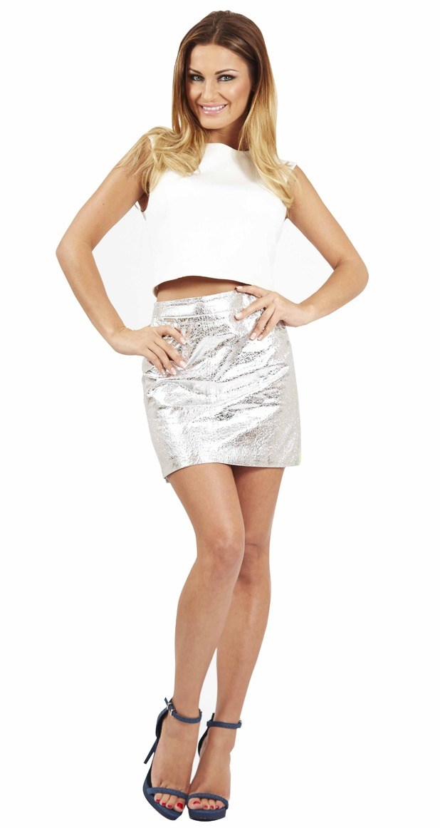 Sam Faiers models a white top, silver skirt and high heels in a picture for her Reveal fashion and beauty column.