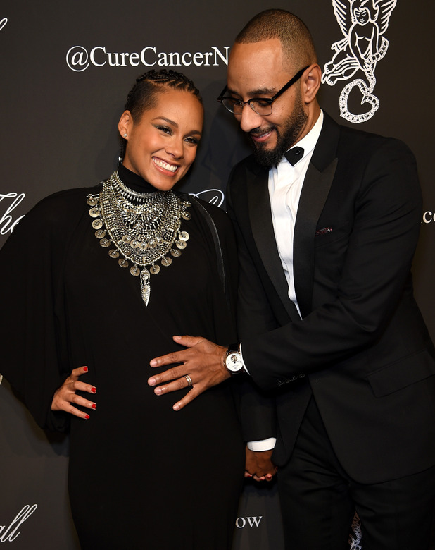 Pregnant Alicia Keys and Swizz Beatz attend Angel Ball 2014 hosted by Gabrielle's Angel Foundation at Cipriani Wall Street on October 20, 2014 in New York City.
