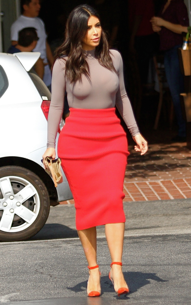 Kim Kardashian, wearing a red pencil skirt and a skin-tight top, has lunch at Fred Segal in Hollywood 10/20/2014