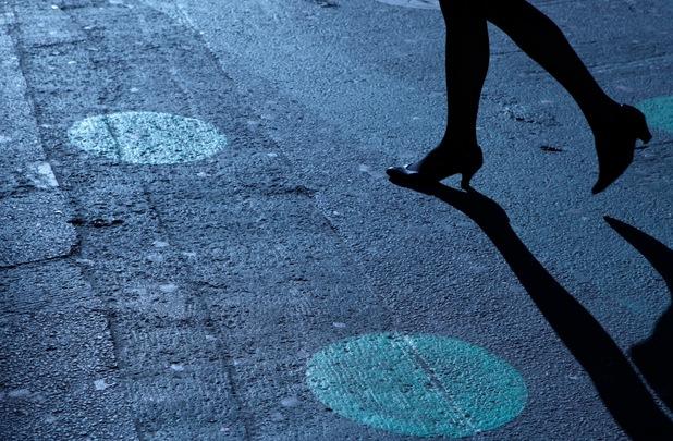 Woman walking alone in street