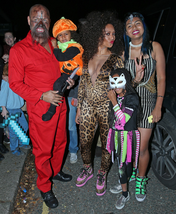 Melanie Brown and husband Stephen Belafonte attend Jonathan Ross' annual Halloween party with family, 31 October 2014
