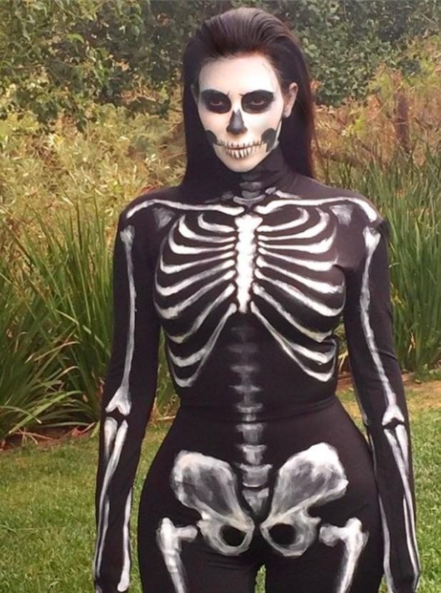 Kim Kardashian dresses as skeleton for Halloween, 1 November 2014