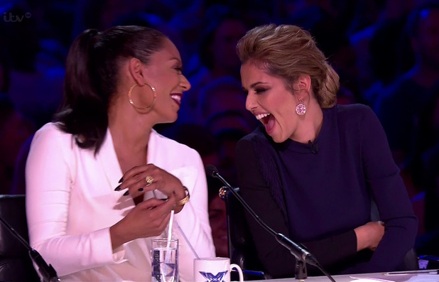 X Factor judge Mel B and Cheryl sharing a joke on the judging panel - 15/9/2014.