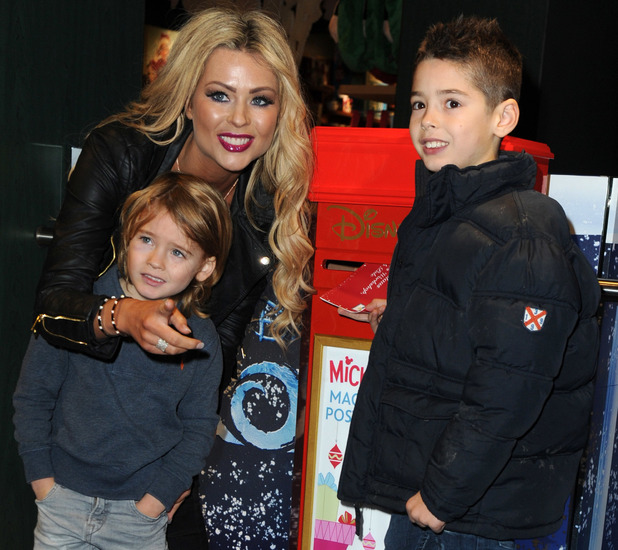 Nicola McLean with sons Rocky and Striker at the launch of Disney Store's 'Share the Magic' Christmas charity campaign in London on 4 November.