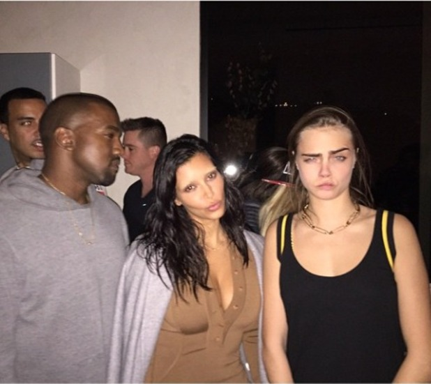 Kim Kardashian shows off her bleached eyebrows, with Kanye West and Cara Delevingne at Kendall Jenner's birthday party, 4 November 2014