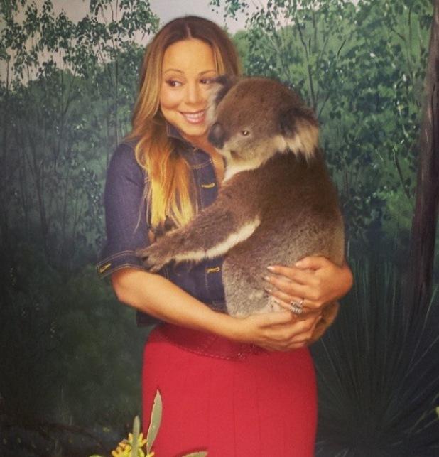 Mariah Carey cuddles up to Edmond the koala at Cleland Conservation Park in Adelaide, South Australia - 4 November 2014.