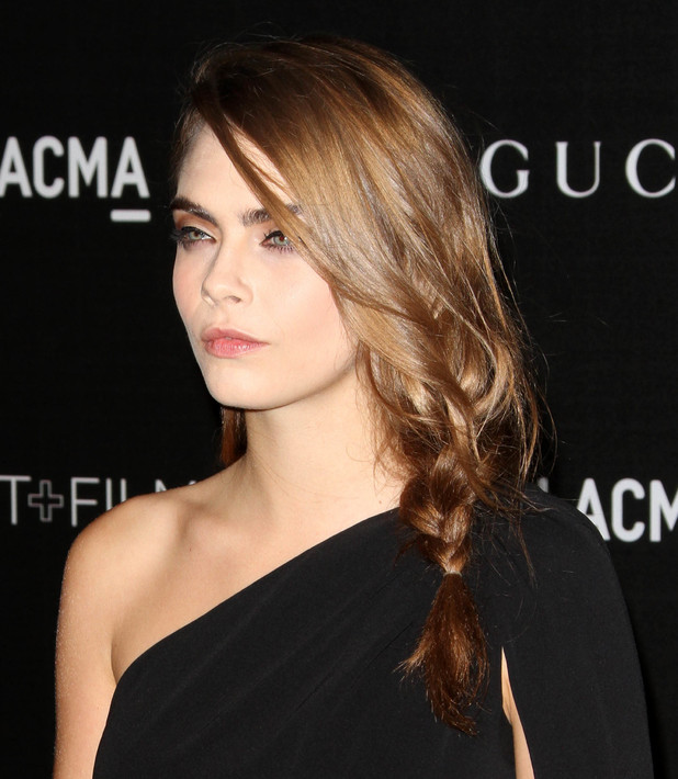 Cara Delevingne shows off her new brunette hair at the 2014 LACMA Art + Film Gala in Los Angeles, America - 1 November 2014