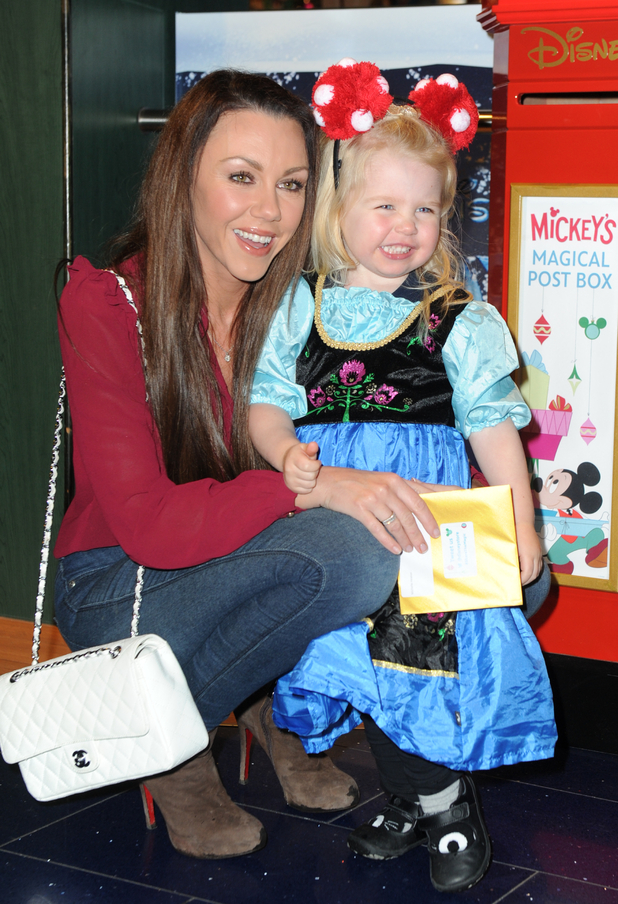 Michelle Heaton and daughter Faith at the Disney Store's Christmas Party, Oxford Street, London 4 November