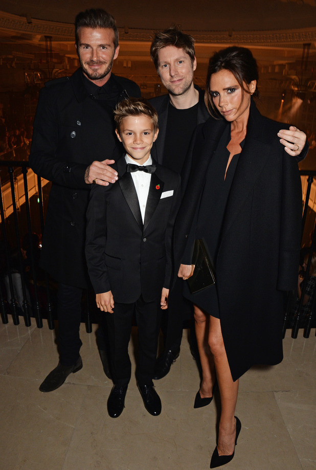 David Beckham, Romeo Beckham, Christopher Bailey and Victoria Beckham attend the launch of the Burberry festive campaign on November 3, 2014 in London, England.