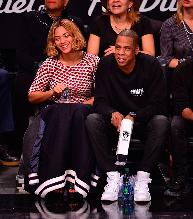 Beyonce Knowles and Jay-Z attend the Oklahoma City Thunder vs Brooklyn Nets game at Barclays Center on November 3, 2014 in the Brooklyn borough of New York City.