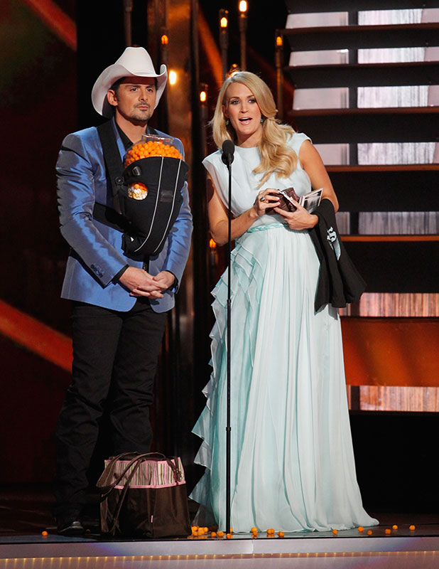 Brad Paisley and Carrie Underwood host the 48th annual CMA awards at the Bridgestone Arena on November 5, 2014 in Nashville, Tennessee. (Photo by Terry Wyatt/FilmMagic)