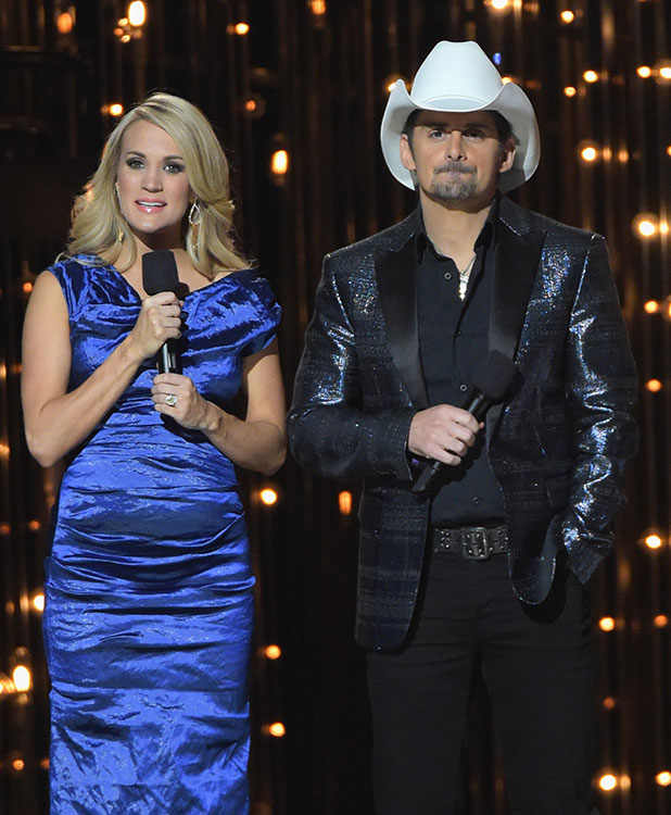 Brad Paisley and Carrie Underwood speak onstage during the 48th annual CMA awards at the Bridgestone Arena on November 5, 2014 in Nashville, Tennessee. (Photo by Rick Diamond/Getty Images)
