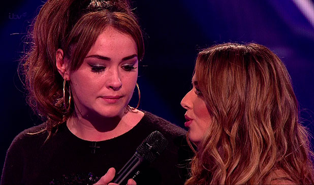 Lola Saunders with Cheryl Fernandez-Versini after Saunders was eliminated from the competition after the sing-off on the results show of 'The X Factor'. Shown on ITV1 HD.