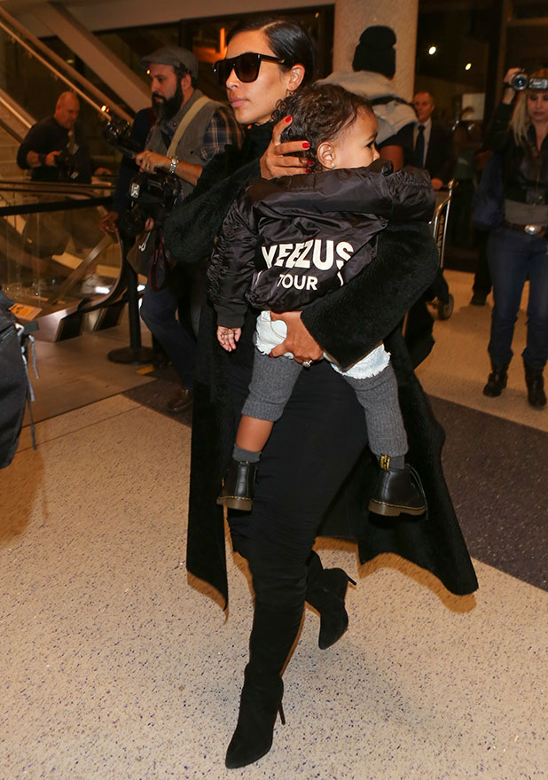 Kim Kardashian and North West are seen at LAX on November 05, 2014 in Los Angeles, California.