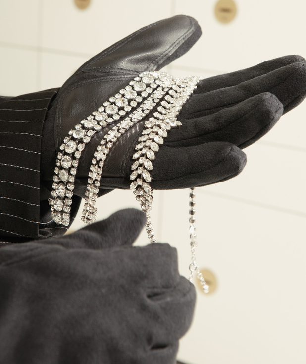 Thief stealing jewellery