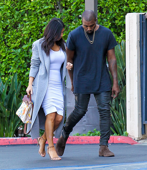 Kim Kardashian and Kanye West head to the Kardashian's office in Los Angeles. Kim is carrying a Hermes bag painted by their daughter North, 10 November 2014