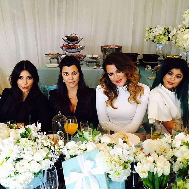 Kourtney Kardashian poses with sisters Kim, Kourtney and Kylie at her baby shower, November 12, 2014 in Los Angeles, California.