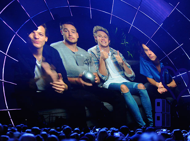 One Direction receive the Best Pop award via video-link on stage during the MTV EMA's 2014 at The Hydro on November 9, 2014 in Glasgow, Scotland. (Photo by Dave Hogan/MTV 2014/Getty Images for MTV)