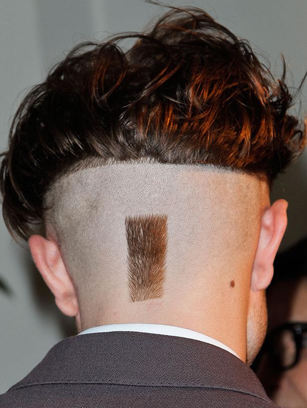 7th Annual Go Go Gala, Beverly Hills, Los Angeles, America - 13 Nov 2014 Robert Pattinson shows off new half-shaven head.