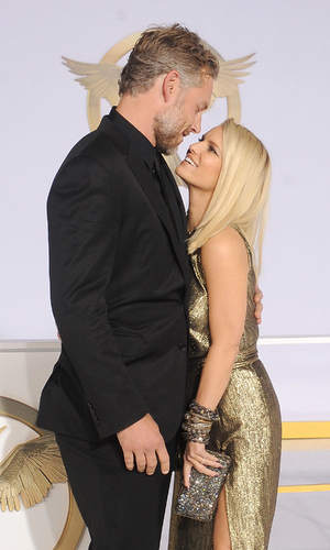 Jessica Simpson and husband Eric Johnson arrive at the Los Angeles premiere of 'The Hunger Games: Mockingjay - Part 1' at Nokia Theatre L.A. Live on November 17, 2014 in Los Angeles, California.