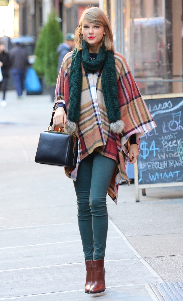 Taylor Swift wears a Topshop cape and scarf while heading out in New York, America - 14 November 2014