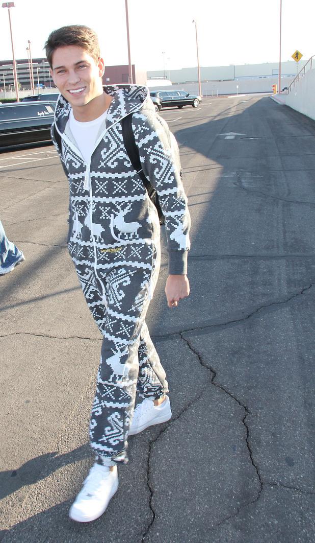 Joey Essex arriving at Las Vegas Maccaran International Airport wearing a christmas style Onesie jumpsuit. Las Vegas, Nevada - 14.12.11